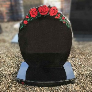 Black round headstone with engraved rose design