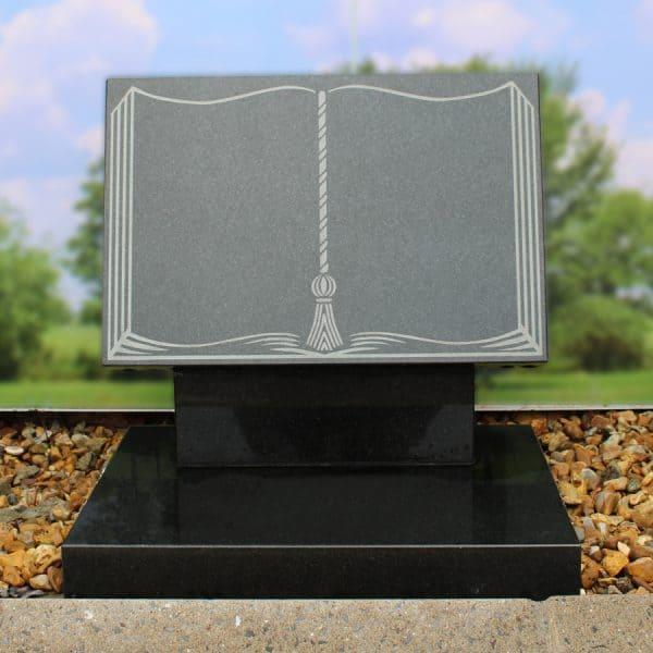 Dark grey granite plaque on riser book memorial