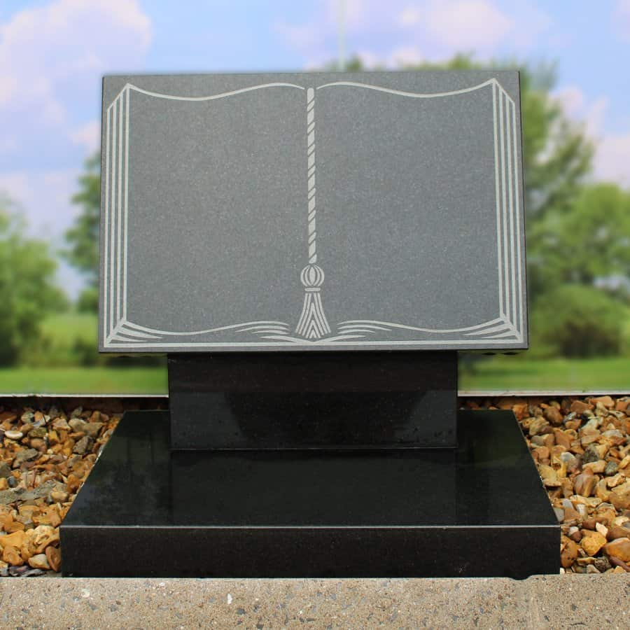 Dark grey granite plaque on riser book memorial
