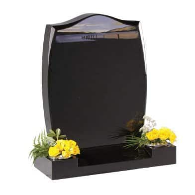 Black granite with chamfered headstone and centre splay base