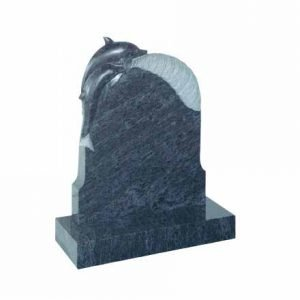 Bahama Blue granite with carved dolphin on a wave