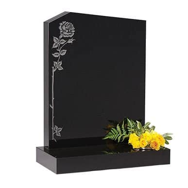 Black granite with peon top and climbing rose