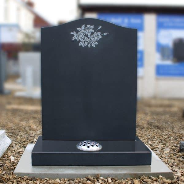 Honed black granite lawn memorial