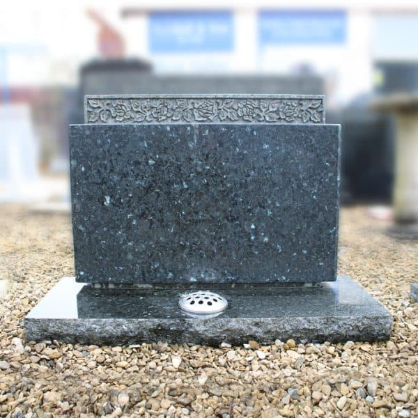 Large emerald pearl granite memorial with deep carved roses